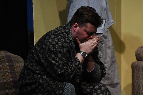 Mr. Van Daan cries. A scene from The Diary of Anne Frank.