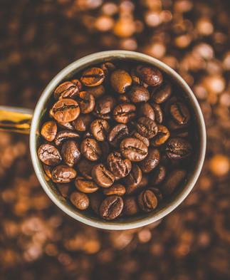 Canva - Mug of Coffee Beans.jpg