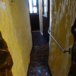 Di's Place - hall to toilet, downhill uneven surface