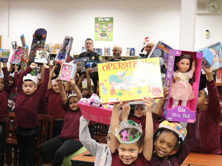 Pleasantville - Sheriff Eric Scheffler celebrates Three Kings Day with students at North Main Street