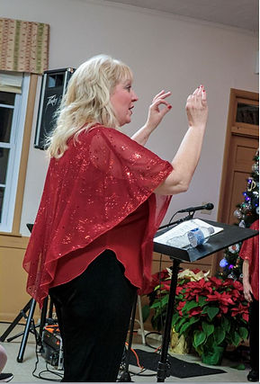 Kat directing holiday concert 2019.JPG