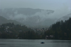 Lake Bled and pletna boat in the rain