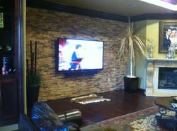 Tv mounted on Stone