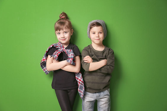 Cute stylish children on color backgroun