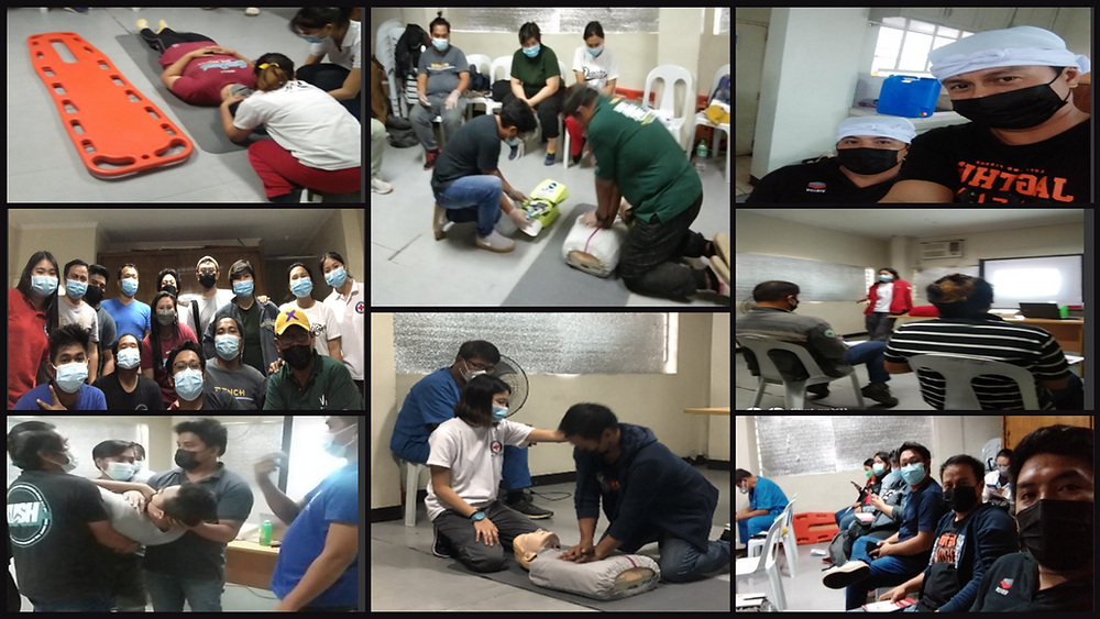 Employees doing life support training by red cross