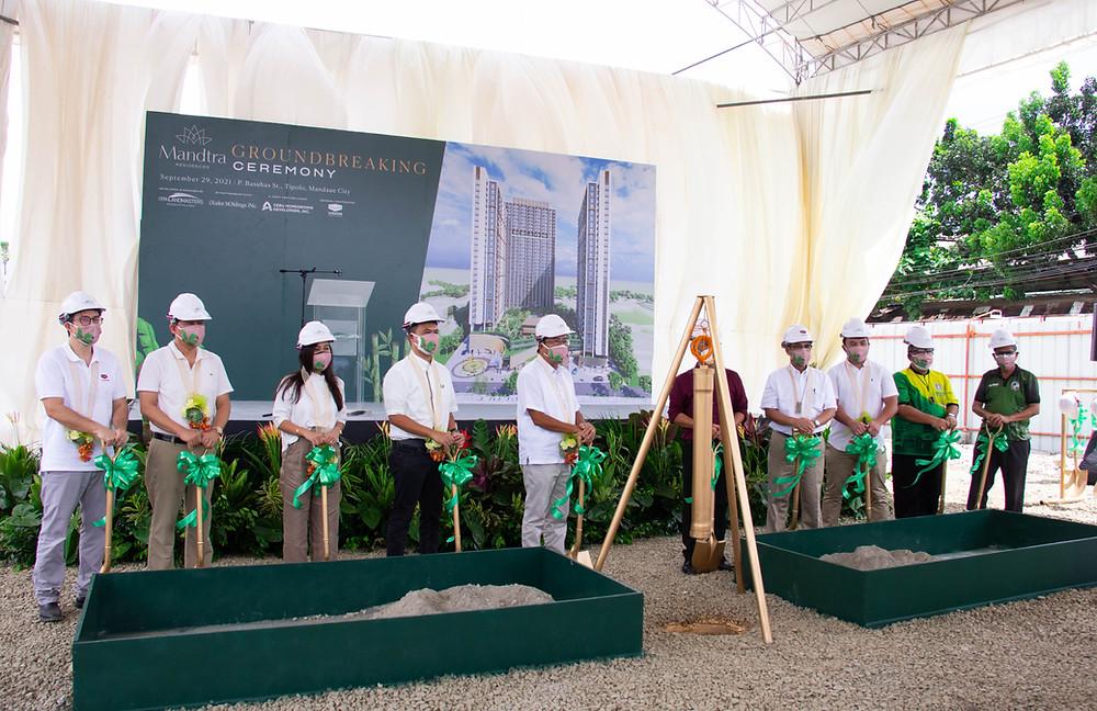 Executive Leaders standing in front of groundbreaking