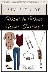 Style guide for what to wear at wine bars with image of Sparkling Vine cork necklace, cork bracelet, dangling earrings, jeans, black pumps, black handbag with tassels, burgundy tank top, & camel flowy jacket