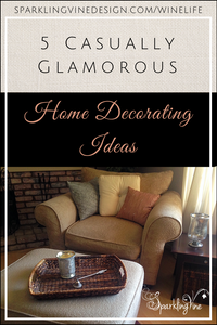 Text reads 5 Casually Glamorous Home Decoration Ideas with image of a comfortable chair with pillows, a matching ottoman, and a seagrass tray with a candle holder