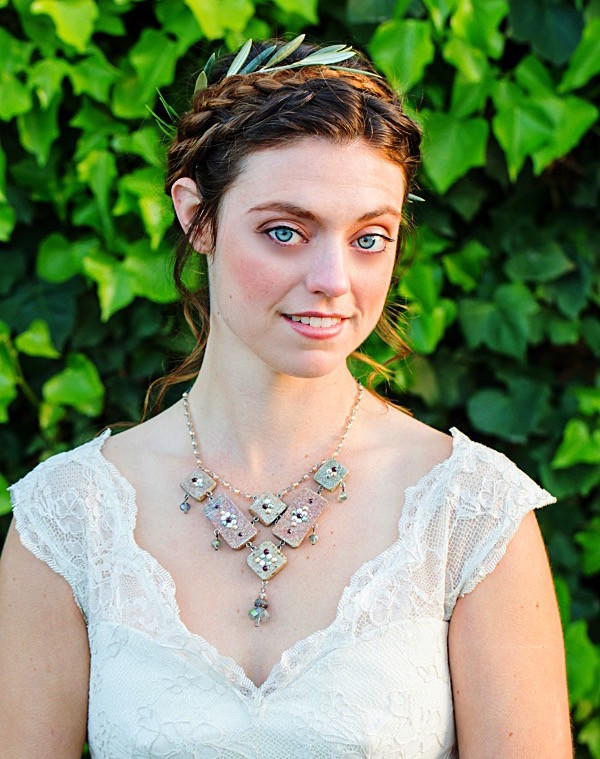 Woman wearing a crystal statement necklace and an outdoor wedding dress at a boho wedding