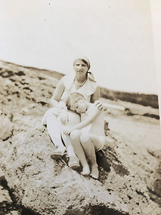 Old photo of woman and child on Kennebunk Beach in Maine