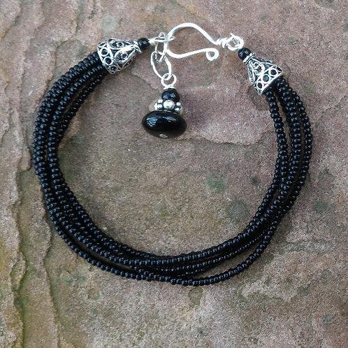 Multistrand black bracelet