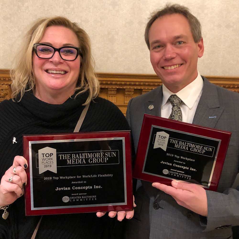 Heather Johnson and Richard Scheper proudly accept two awards for Jovian Concepts, named Top Workplace 2019 by the Baltimore Sun.