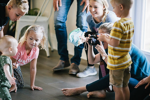 woman photographing child personality