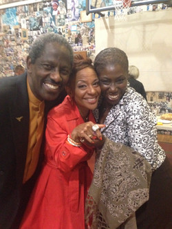 Renel Brooks-Moon showing off the Giants Championship ring with Rev. Roland Gordon