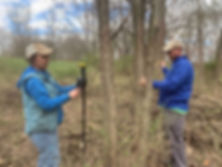 Molly Gosness, GIS specialist, and arborist Nick Goergen explain conducting a tree inventory on Prairie Birthday Farm.