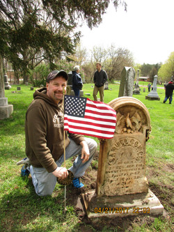 Steve proudlygetting a flag and marker on Samuel Comers Stone