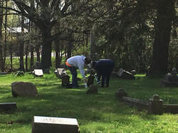 Jen Price and William Luther Cleaning some Infant headstones