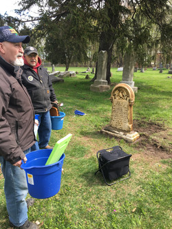 Ron Hyre andBill Adams supervising the work on the Samuel Comer Headstone