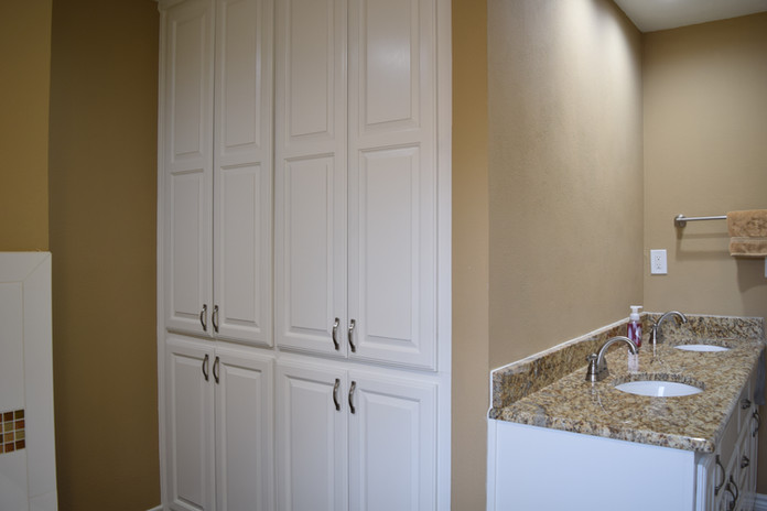 White Cabinets Bathroom Remodel