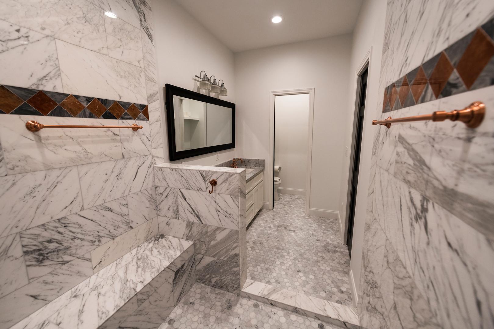 White Carrera Bathroom Remodel