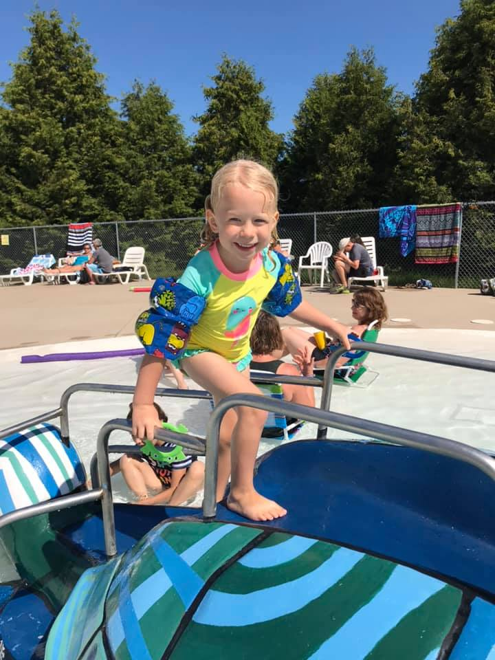 Child enjoying the turtle slide 2019