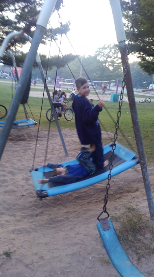 Kids enjoying the new swings at park