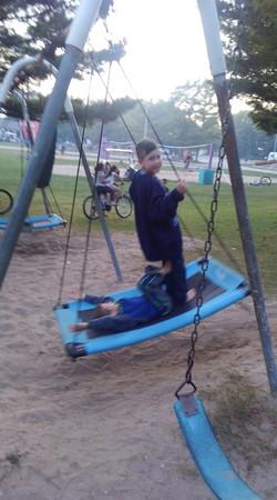 Kids enjoying new swings 2019