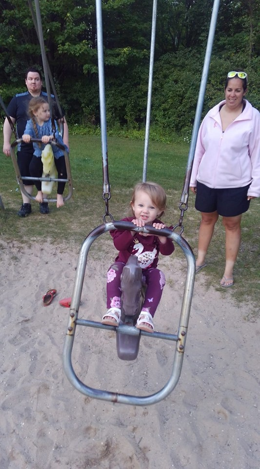 Kid enjoying swings