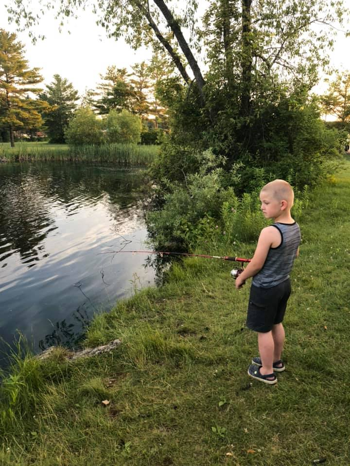 Kid fishing in Fishing Pond
