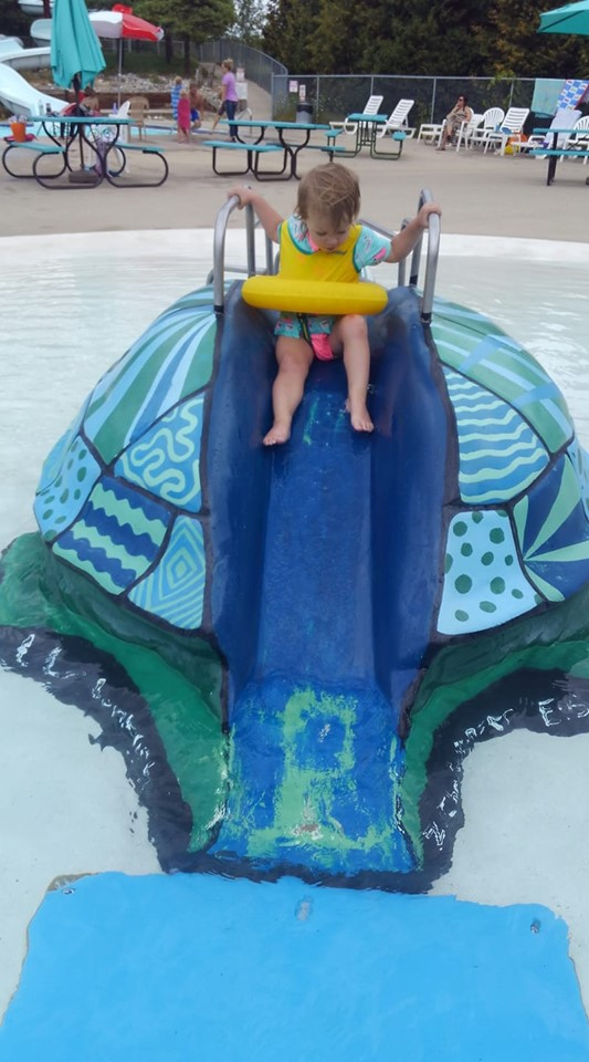 Kid enjoying the turtle slide 2019