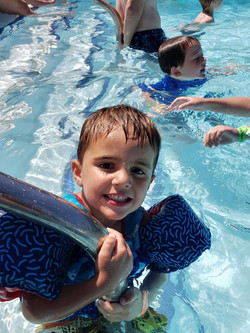 Kid enjoying the pool 2019