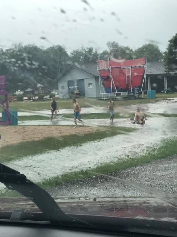 Kids enjoying the storm flooding us