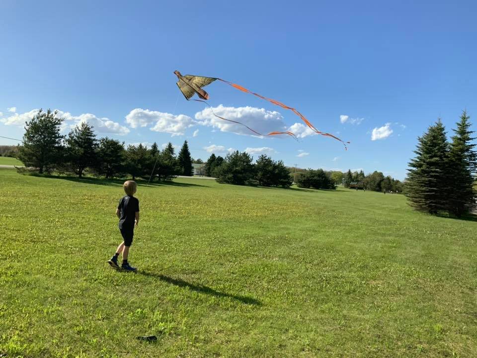 Kid flying a kite 2019