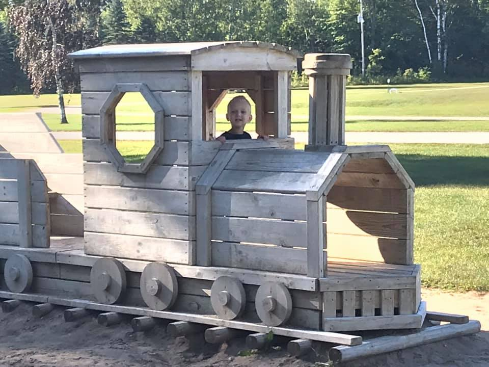 Kid in train at playground