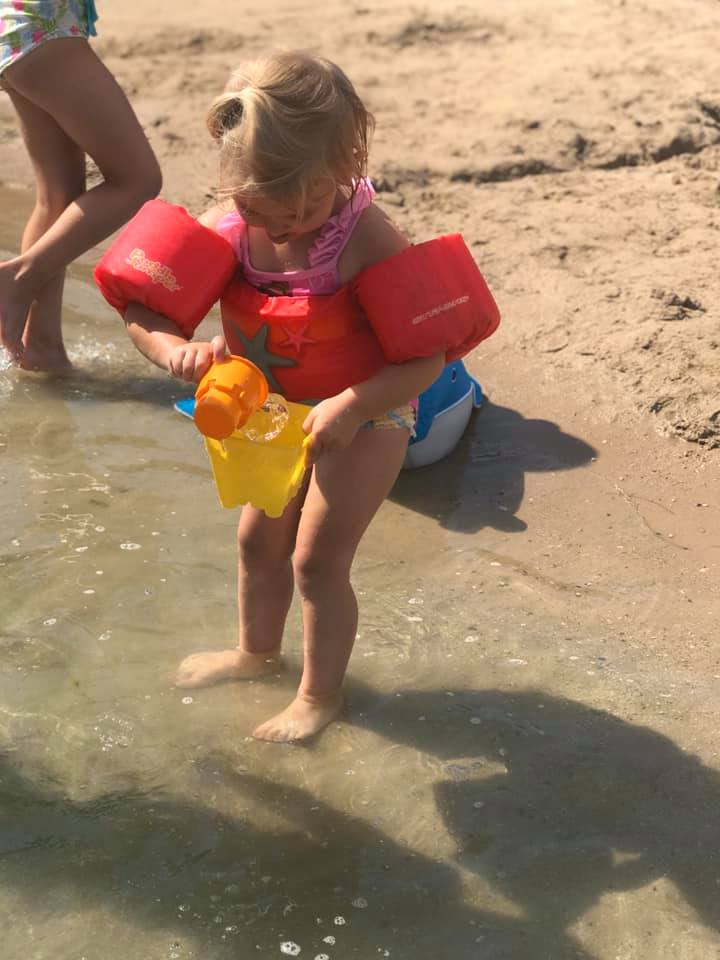 Kid playing on beach at Oasis 2019