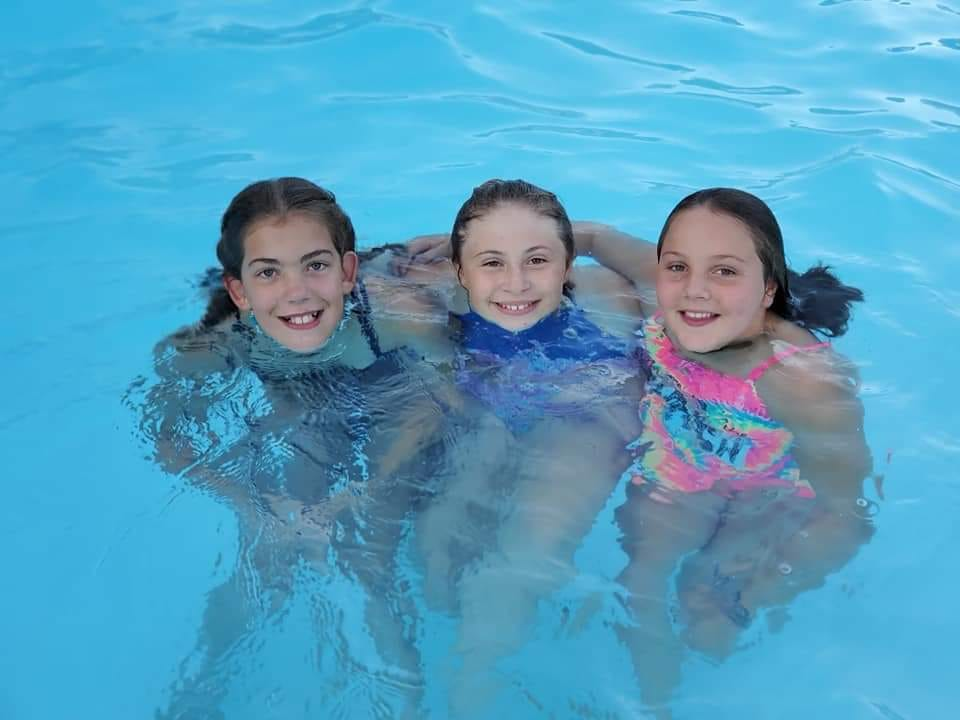 Kids posed in the pool 2019