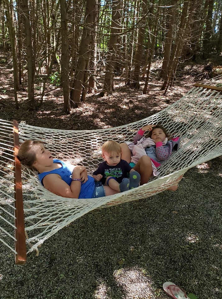 Campers enjoying their hammock