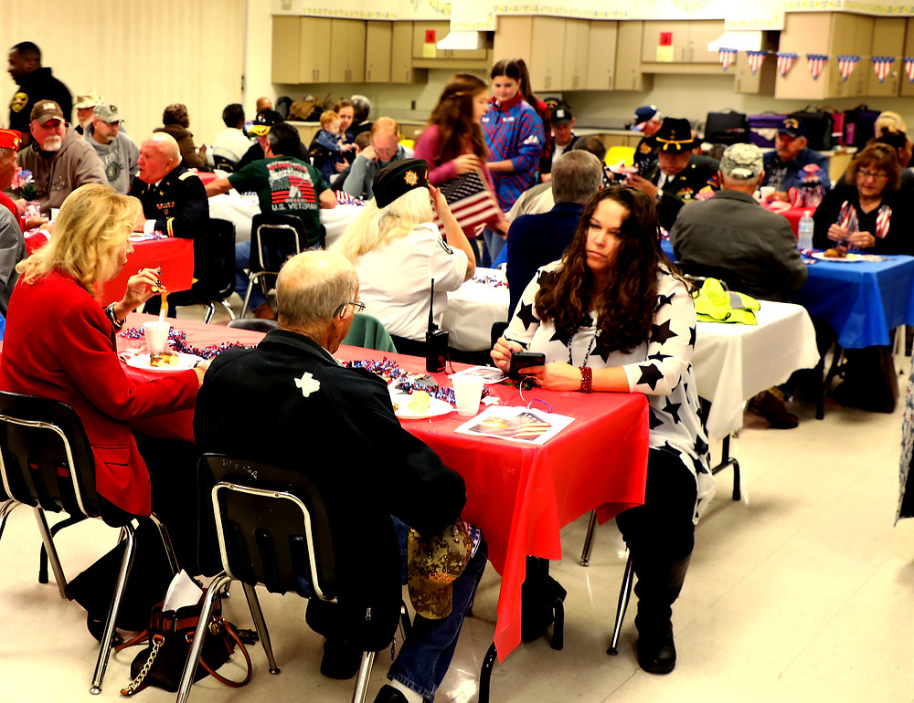 Scott Middle School students served a hearty breakfast to dozens of local veterans, soldiers and heroes during the school's annual Salute to Veterans