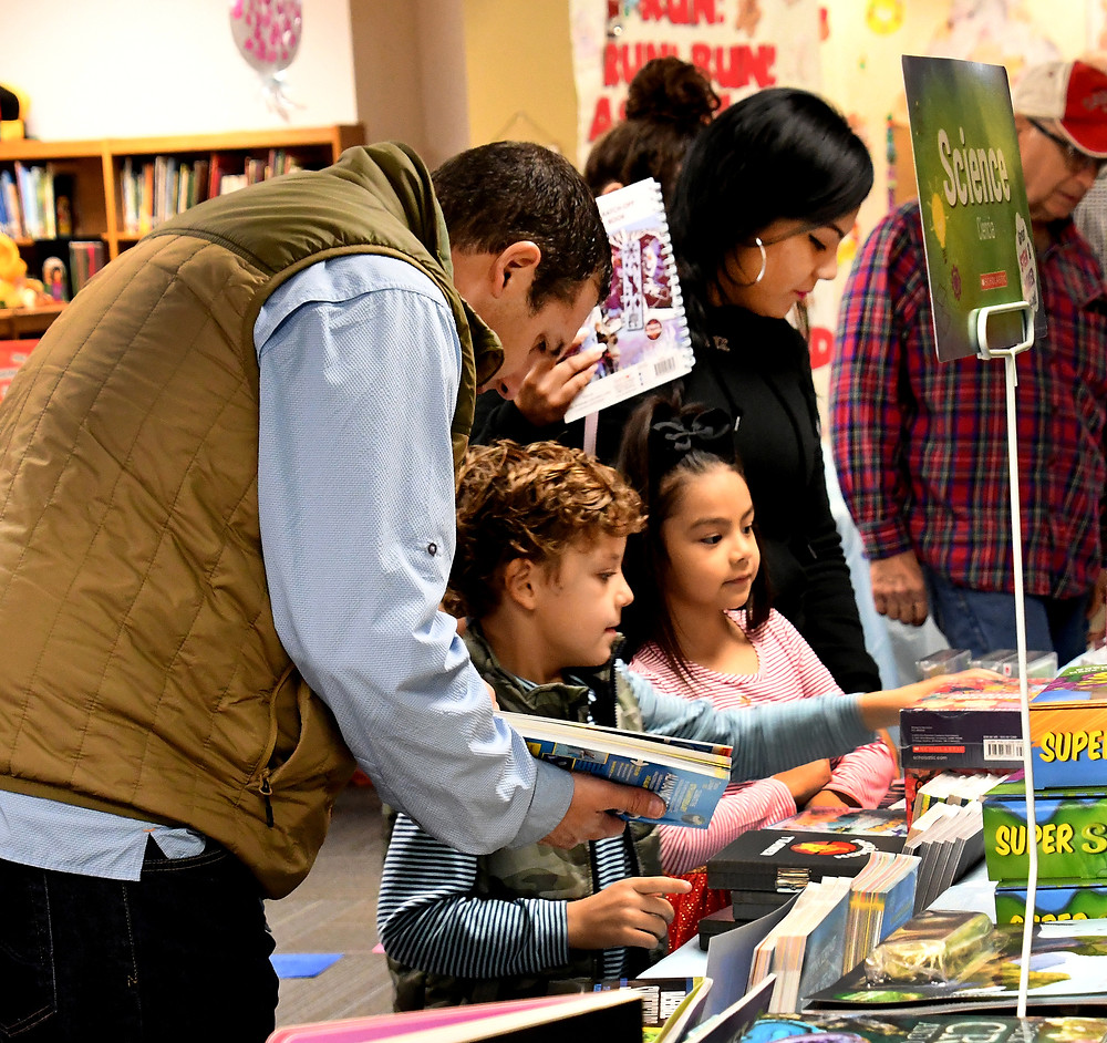 Mayes Elementary parents and students shop together at the book fair