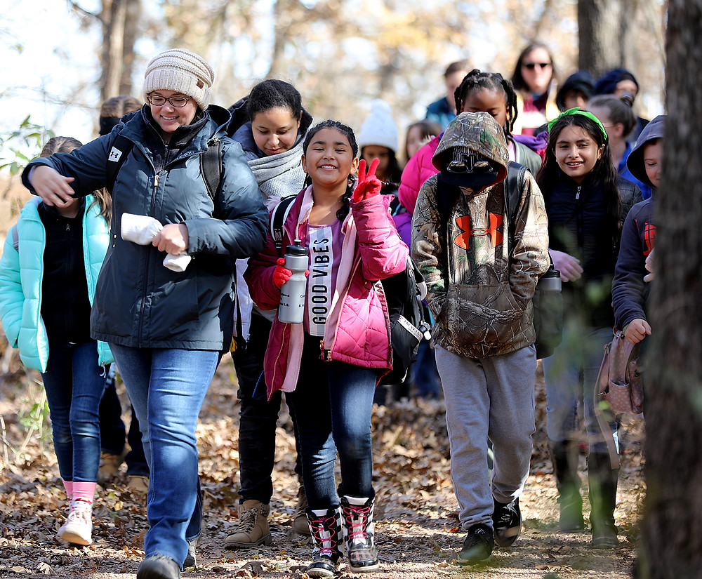 Denison fifth graders hike trails and learn about archeology, geology, paleontology, ecology