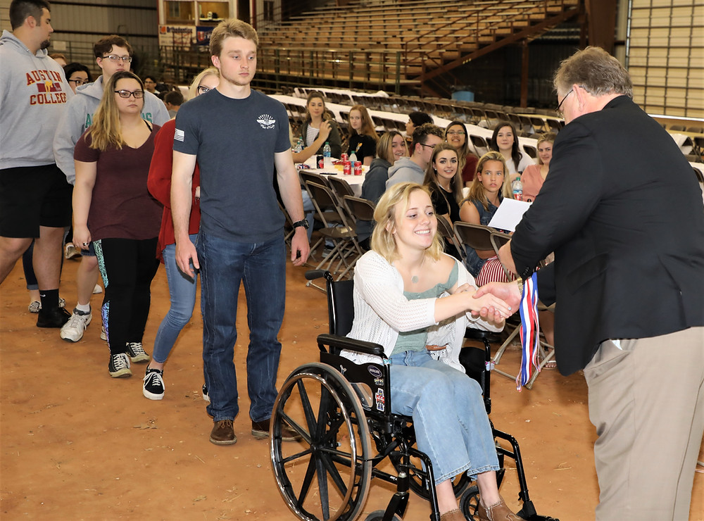 Dr. Cavin Boettger, DHS Principal, presented Texas Scholars medals to 136 graduating DHS seniors who have successfully completed a more rigorous high school curriculum as recommended by the State of Texas. The occasion: the annual Texas Scholars picnic at Loy Park's Mayor Arena.