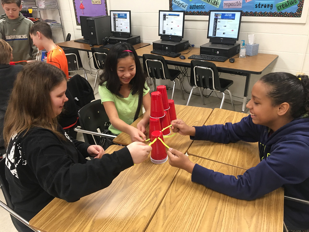 B. McDaniel students work together on a project