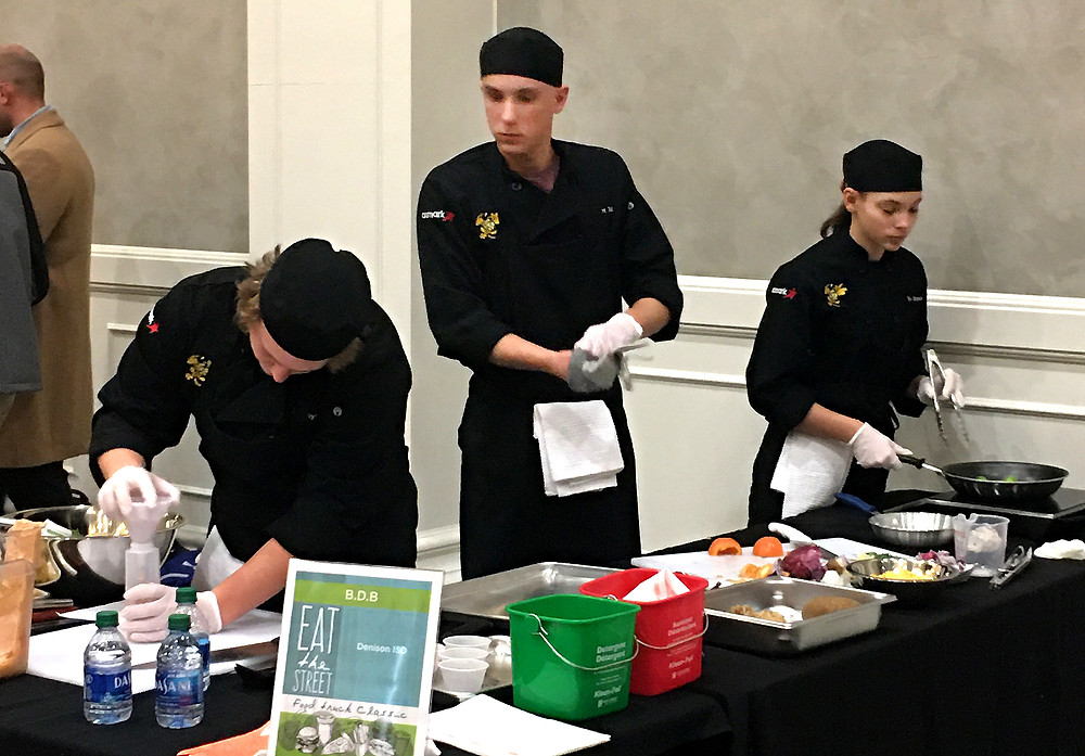 DHS chefs prepare their dish during the state competition