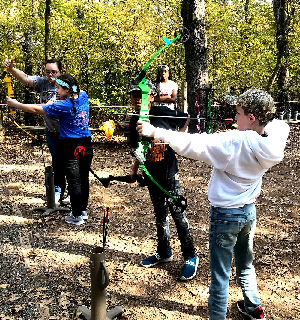 B. McDaniel fifth graders learn and sharpen their archery skills