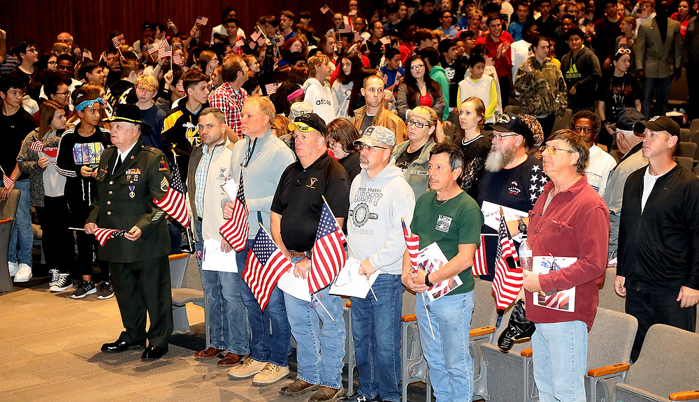 Scott Middle School students stood to honor local veterans, soldiers and heroes