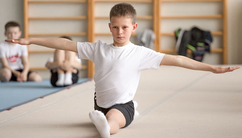 Child Practicing Gymnastics_edited.jpg