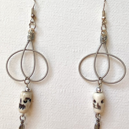 Guitar string knots with bone skulls and leaves