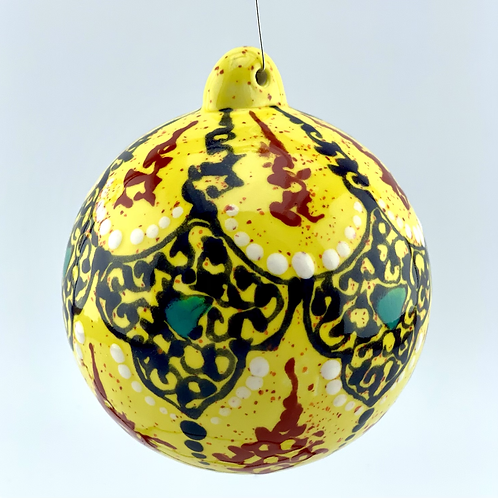 Yellow ornament with stand