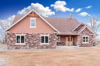 Custom home exterior featuring stucco, s