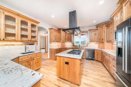 Custom Alder kitchen cabinets featuring